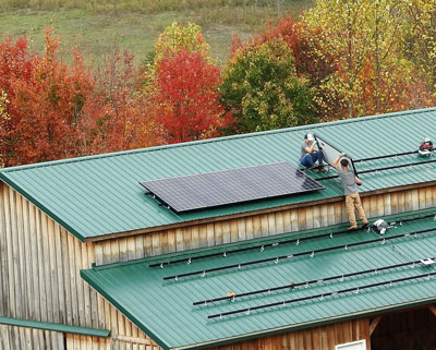 Solar Panels Being Installed on Barn Roof