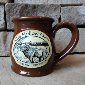 Ten ounce belly mug with cinnamon color glaze and embossed logo of Elm Hollow Farm