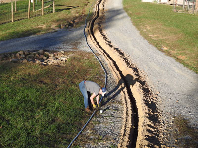 Solar Power Installer Preparing Underground Cable Run
